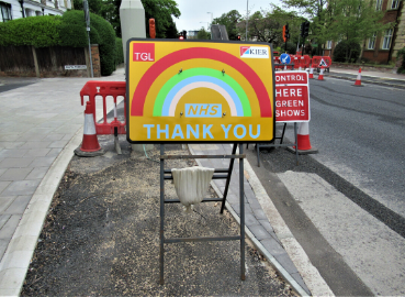 A roadworks sign on Ewell Road celebrating the NHS during the COVID-19 lockdown.