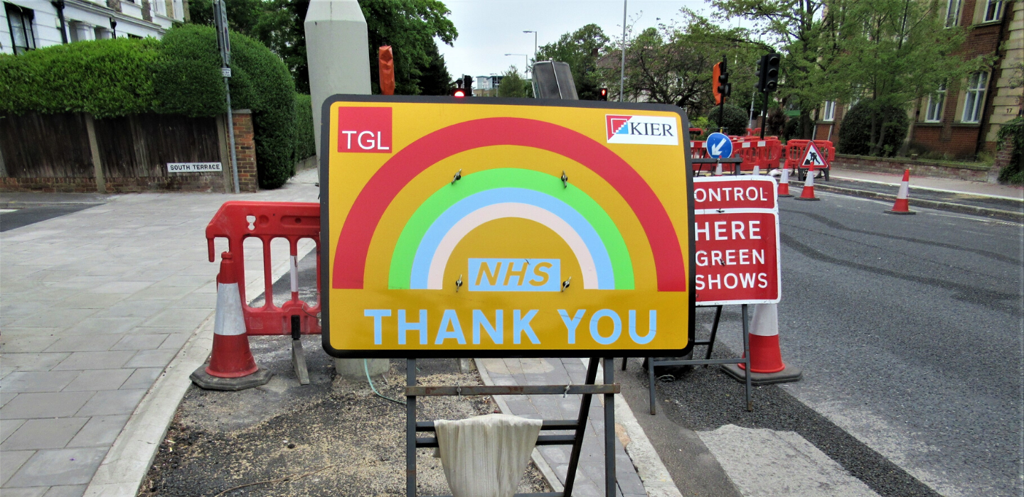 A traffic sign on Ewell Road thanking the NHS with a rainbow