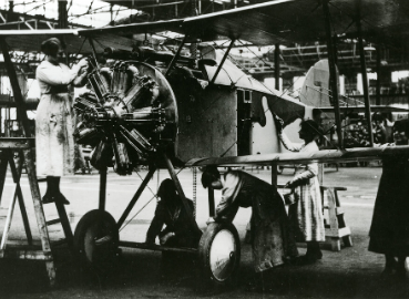 A photograph of women working on a plane in an aircraft factory from the photo collection at Kingston History Centre.
